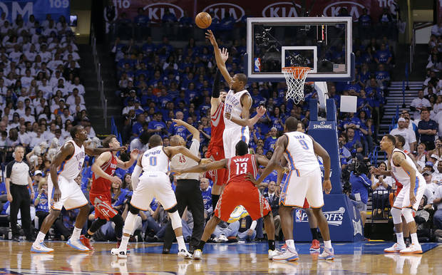Oklahoma City's Kevin Durant (35) and Houston's Carlos Delfino (10) go after a jump ball during Game 2 in the first round of the NBA playoffs between the Oklahoma City Thunder and the Houston Rockets at Chesapeake Energy Arena in Oklahoma City, Wednesday, April 24, 2013. Photo by Chris Landsberger, The Oklahoman