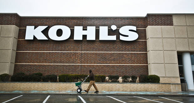 Crews spread ice melt on the sidewalks outside of Kohl's to prepare for the winter weather conditions that are forecasted for the state on Thursday, Jan. 28, 2010, in Yukon, Okla.   Photo by Chris Landsberger, The Oklahoman