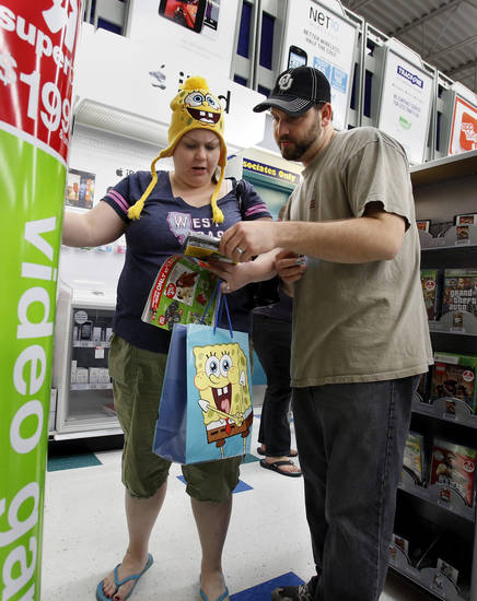 Tara and Dwayne Robinett shop at Toys R Us as they open on Thanksgiving Day for pre-Black Friday Sales on Thursday, Nov. 22, 2012, in Norman, Okla.  Photo by Steve Sisney, The Oklahoman
