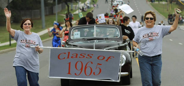 Representatives of Carl Albert's class of 1965 marched in the parade. Carl Albert High School is celebrating its 50th birthday this year and students and alumni participated in homecoming week activities, including a two-mile long parade before the football game on Friday, Oct. 12, 2012.    Photo by Jim Beckel, The Oklahoman