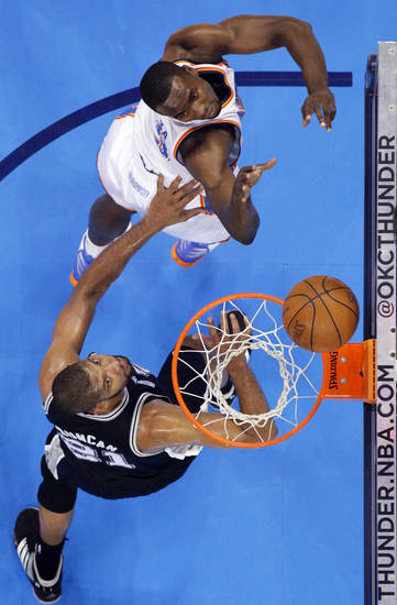 Oklahoma City's Serge Ibaka (9) shoots over San Antonio's Tim Duncan (21) during Game 6 of the Western Conference Finals between the Oklahoma City Thunder and the San Antonio Spurs in the NBA playoffs at the Chesapeake Energy Arena in Oklahoma City, Wednesday, June 6, 2012. Photo by Chris Landsberger, The Oklahoman