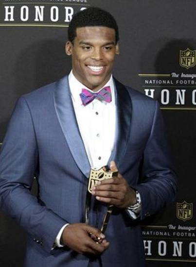 Cam Newton shows off his style when he accepted the trophy for Associated Press Offensive Rookie of the Year in February.