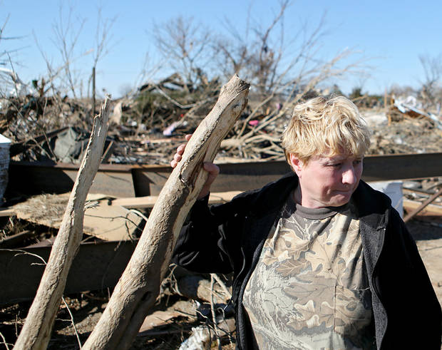 Margie Hughes looks at the damage to her home following deadly storms around Lone Grove, Okla., Feb. 11, 2009. By John Clanton, The Oklahoman