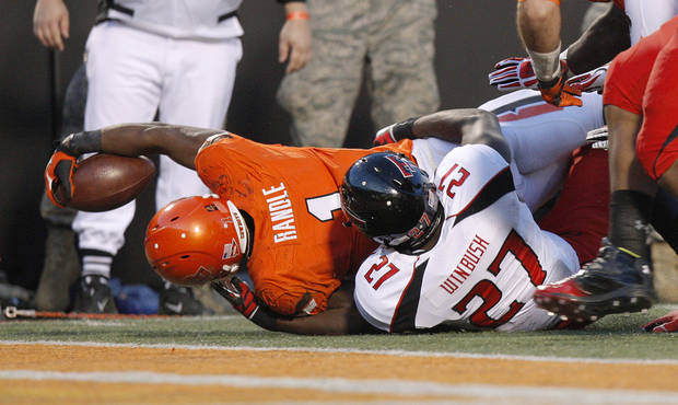 Oklahoma State's Joseph Randle (1) is brought down short of the end zone by Texas Tech's Zach Winbush (27) during a college football game between Oklahoma State University (OSU) and Texas Tech University (TTU) at Boone Pickens Stadium in Stillwater, Okla., Saturday, Nov. 17, 2012.  Photo by Bryan Terry, The Oklahoman