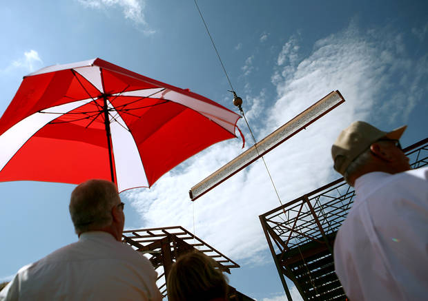 An audience watches as a steel beam is raised during a topping out ceremony at the new Yukon High School still under construction in Yukon, Okla., on Tuesday, August 31, 2010. Photo by John Clanton, The Oklahoman