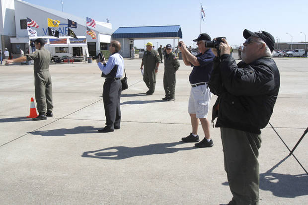 Avation fans take photos as the last airworthy B-29 Superfortress flies into Wiley Post Airport in Oklahoma City, OK, Tuesday, October 2, 2012. It will be on exhibit for six days at Wiley Post Airport.  By Paul Hellstern, The Oklahoman
