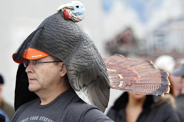 John McDougal, wearing a turkey headdress, waits for the start of the Turkey Trot.