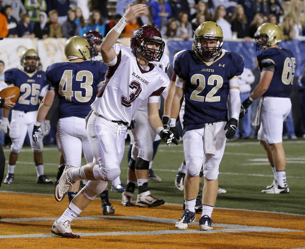 Blanchard's Zach Hill reacts after scoring a touchdown beside Kingfisher's Jake Blair during the Class 3A football championship between Blanchard and Kingfisher at Boone Pickens Stadium in Stillwater, Okla., Friday, Dec. 7, 2012.  Photo by Bryan Terry, The Oklahoman