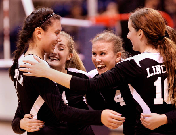 Lincoln Christian players celebrate with Serena Mar, left, after she scored a crucial point against Cache  in the Class 4A State Championship volleyball game at Shawnee High School, Saturday afternoon, Oct. 8, 2011. Lincoln Christian won the championship game, 3-2.   Photo by Jim Beckel, The Oklahoman