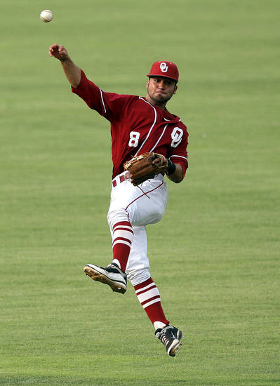 Oklahoma&#039;s Jack Mayfield throws to first during the Bedlam baseball game between the University of Oklahoma and Oklahoma State University at the Chickasaw Bricktown Ballpark in Oklahoma City, Sunday, May 6, 2012. Photo by Sarah Phipps, The Oklahoman