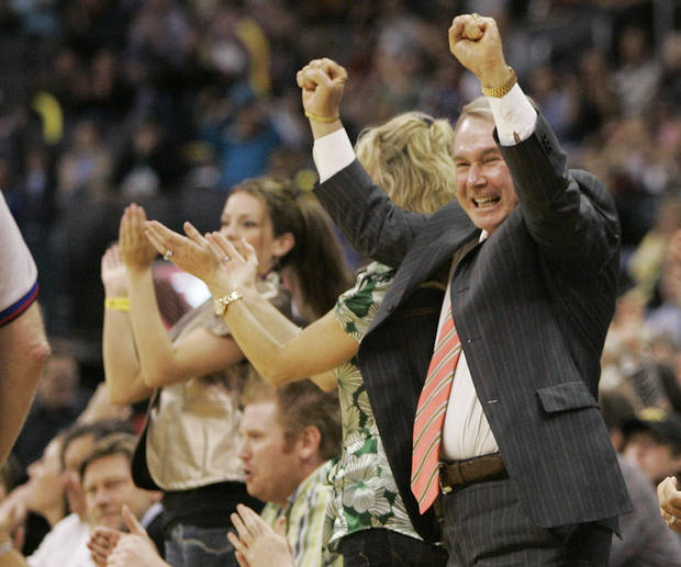 New Orleans Hornets owner George Shinn reacts after the Hornets scored against the Los Angeles Clippers in overtime of an NBA basketball game in Oklahoma City, Tuesday, April 10, 2007. The Hornets won the game 103-100.  (AP Photo/Sue Ogrocki) ORG XMIT: OKSO107
