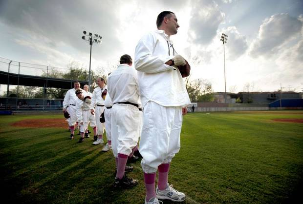 Former major league pitcher Damon Minor holds his hand over his heart during the national anthem during the re-enactment 1889 baseball game between the Guthrie Dudes and Oklahoma City Pirates at Squires Field in Guthrie, Okla., Friday, April 24, 2009. Photo by Sarah Phipps, The Oklahoman