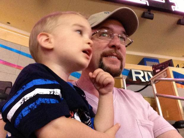 Altus cotton farmer Danny Robbins and grandson Axel enjoy a Thunder game at the Chesapeake Energy Arena. <strong>provided</strong>