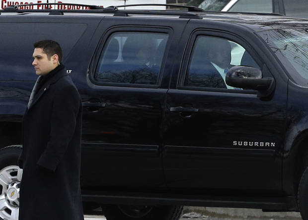 First lady Michelle Obama, center, arrives for the funeral for Hadiya Pendleton at the Greater Harvest Missionary Baptist Church Saturday, Feb. 9, 2013, in Chicago. The shooting death of the 15-year-old honor student has drawn attention to the staggering gun violence in the nation's third-largest city. (AP Photo/Nam Y. Huh)
