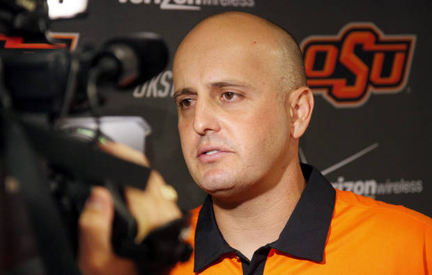 Josh Holliday gives a television interview after a press conference at Oklahoma State University to introduce him as OSU's new head baseball coach, in Stillwater, Okla., Friday, June 8, 2012. Photo by Nate Billings, The Oklahoman