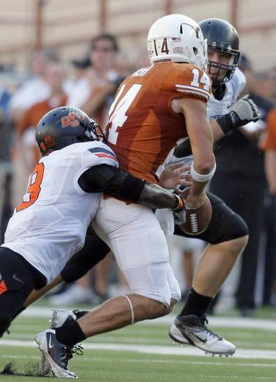 Oklahoma State's Daytawion Lowe (8) forces Texas' David Ash (14) to fumble in the fourth quarter of a college football game between the Oklahoma State University Cowboys (OSU) and the University of Texas Longhorns (UT) at Darrell K Royal-Texas Memorial Stadium in Austin, Texas, Saturday, Oct. 15, 2011. Photo by Sarah Phipps, The Oklahoman