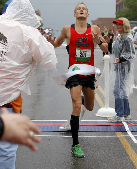 Jake Bohler of Edmond wins the the Oklahoma City Memorial Marathon in Oklahoma City, Sunday, April 29, 2012. Photo by Bryan Terry, The Oklahoman