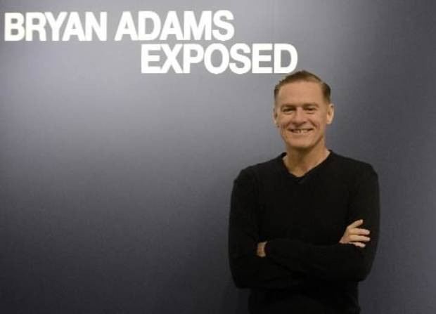 "Canadian rock star Bryan Adams poses during the opening of his photo exhibition ""Exposed"" in Duesseldorf, Germany, Friday, Feb. 1, 2013. Another installment of the exhibit opens Tuesday at Oklahoma Contemporary Arts Center, formerly City Arts Center. (AP Photo)"