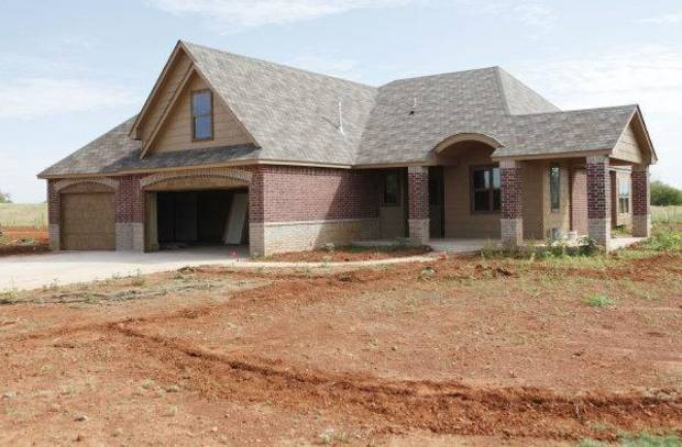 This home at 6909 NW 161 is by Steve Allen of Allenton Homes & Development. <strong>PAUL HELLSTERN - The Oklahoman</strong>