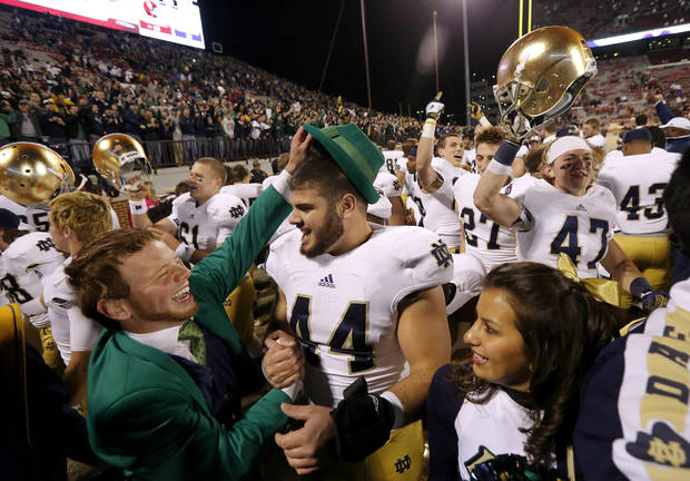 Notre Dame's Carlo Calabrese (44) celebrates after the college football game between the University of Oklahoma Sooners (OU) and the Notre Dame Fighting Irish at Gaylord Family-Oklahoma Memorial Stadium in Norman, Okla., Saturday, Oct. 27, 2012. Oklahoma lost 30-13. Photo by Bryan Terry, The Oklahoman