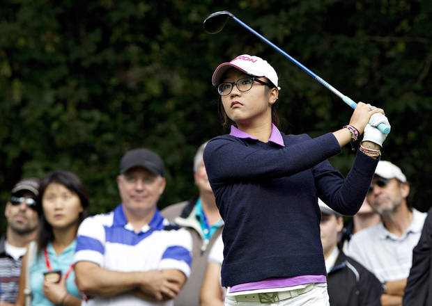 Lydia Ko, of New Zealand, drives off the second tee box during the final round of the LPGA Canadian Women's Open golf tournament in Edmonton, Alberta, Sunday, Aug. 25, 2013. (AP Photo/The Canadian Press, Jason Franson)