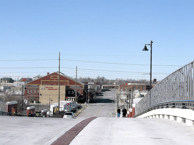 Pedestrians cross the new Boulder Avenue bridge into the Brady District. Photo by Steve Lackmeyer, The Oklahoman