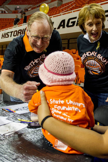 OSU President Burn Hargis shakes the hand of Isabella Roman.  Oklahoma State University hosted a Coaches vs. Cancer Birthday party in Gallagher-Iba arena in Stillwater, Ok on Sept. 16, 2012. Photos by Mitchell Alcala for the Oklhaoman