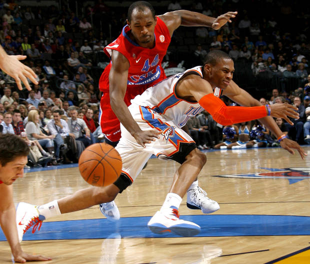 EXHIBITION NBA BASKETBALL GAME: Oklahoma City's Russell Westbrook (0) loses the ball in front of CSKA Moscow's Jamont Gordon (44) during the preseason NBA basketball game between the Oklahoma City Thunder and CSKA Moscow in Oklahoma City, Thursday, October 14, 2010. Photo by Bryan Terry, The Oklahoman ORG XMIT: KOD