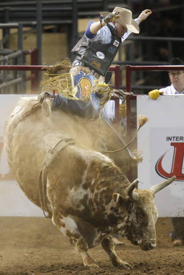Eric Isabelle of Ste-Julienne, Quebec, Canada jumps off a bull during the bull riding event at the International Finals Rodeo at the State Fair Arena in Oklahoma City,  Saturday, Jan. 19, 2013. Photo by Sarah Phipps, The Oklahoman