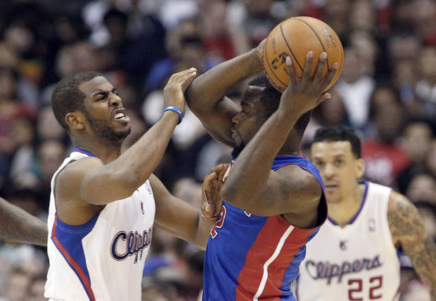 Detroit Pistons guard Will Bynum (12) tries to pass and is defended by Los Angeles Clippers guard Chris Paul (3) with forward Matt Barnes (22) in the first half of an NBA basketball game in Los Angeles Sunday, March 10, 2013.  (AP Photo/Reed Saxon)