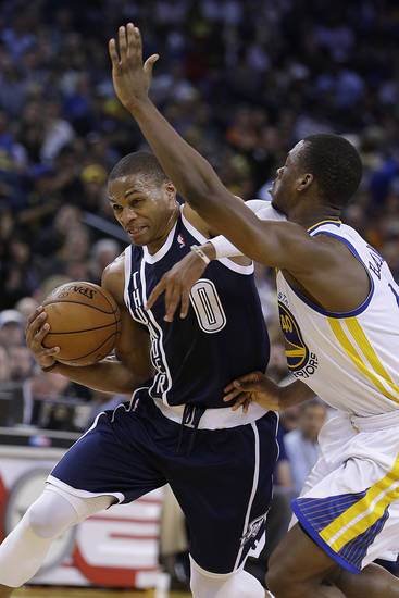 Oklahoma Thunder guard Russell Westbrook (0) past Golden State Warriors' Harrison Barnes during the first half of an NBA basketball game Thursday, April 11, 2013, in Oakland, Calif. (AP Photo/Ben Margot)