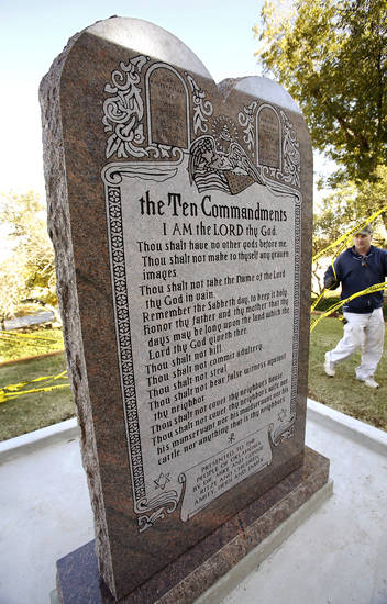 Six-foot tall granite monument of the Ten Commandments  is erected on the north side of the state Capitol grounds Thursday morning, Nov. 15, 2012.  Photo by Jim Beckel, The Oklahoman