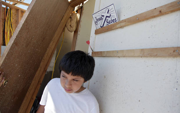 Kiko Martinez walks thorough his house that was destroyed by a tornado on Tuesday west of El Reno, Wednesday, May 25, 2011. Photo by Chris Landsberger, The Oklahoman