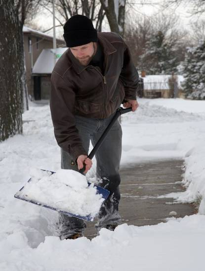Take care not to raise your blood pressure when shoveling snow. (NewsUSA)