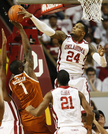 Oklahoma's Romero Osby (24) blocks a shot by Texas' Sheldon McClellan (1) as Oklahoma's Cameron Clark (21) looks on during a men's college basketball game between the University of Oklahoma (OU) and the University of Texas at the Lloyd Noble Center in Norman, Okla., Monday, Jan. 21, 2013. Photo by Nate Billings, The Oklahoman
