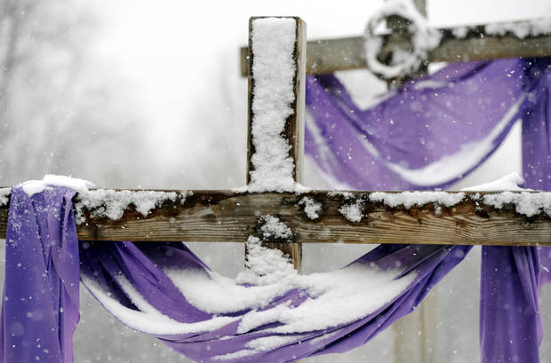 Snow accumulates on crosses at the Church of St John the Baptist in Larksville, Pa., Monday March 25, 2013.  There were no major problems reported despite the widespread snowfall.  (AP Photo/The Citizens' Voice, Mark Moran)  MANDATORY CREDIT   Mark Moran PAWIC102