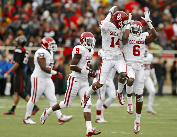 Oklahoma's Aaron Colvin (14) celebrates after an interception with Demontre Hurst (6) during a college football game between the University of Oklahoma (OU) and Texas Tech University at Jones AT&T Stadium in Lubbock, Texas, Saturday, Oct. 6, 2012. Oklahoma won 41-20. Photo by Bryan Terry, The Oklahoman