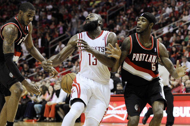 Portland Trail Blazers' Jared Jeffries, left, and Will Barton (5) strip the ball from Houston Rockets' James Harden (13) in the second half of an NBA basketball game, Saturday, Nov. 3, 2012, in Houston. Portland won in overtime 95-85. (AP Photo/Pat Sullivan) ORG XMIT: HTR111