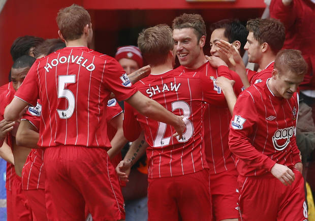 Southampton's Rickie Lambert, center, celebrates his goal against Chelsea with teammates during their English Premier League soccer match at St Mary's stadium, Southampton, England, Saturday, March 30, 2013. (AP Photo/Sang Tan)