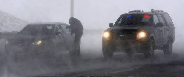 An El Reno police officer checks on a motorist stranded by a snow storm while parked on SH 81 at I-40 in El Reno Thursday, Dec. 24, 2009. I-40 is closed due to blizzard conditions. Photo by Paul B. Southerland, The Oklahoman