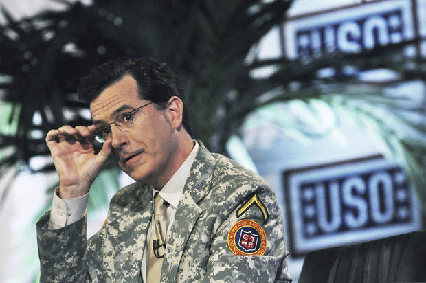 "In this June 7, 2009, file photo originally released by the USO, comedian Stephen Colbert, from the Comedy Central television program, ""The Colbert Report,"" us shown during a taping the first of four shows in front of U.S. soldiers at Camp Victory in Baghdad, Iraq. COLBERT will broadcast two special episodes of Comedy Central's ""The Colbert Report"" to celebrate the end of combat operations in Iraq and to honor returning troops.(AP Photo/USO, Steve Manuel, file) ORG XMIT: NYET283"
