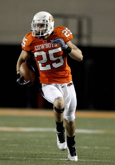 OSU's Josh Cooper (25) runs upfield during the college football game between the Oklahoma State University Cowboys (OSU) and the Troy University Trojans at Boone Pickens Stadium in Stillwater, Okla., Saturday, Sept. 11, 2010. Photo by Sarah Phipps, The Oklahoman
