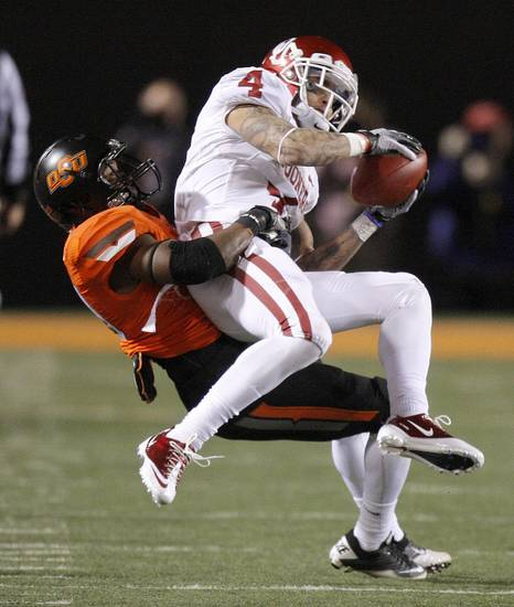 Oklahoma&#039;s Kenny Stills (4) is brought down by Oklahoma State&#039;s Brodrick Brown (19) during the Bedlam college football game between the Oklahoma State University Cowboys (OSU) and the University of Oklahoma Sooners (OU) at Boone Pickens Stadium in Stillwater, Okla., Saturday, Dec. 3, 2011. Photo by Bryan Terry, The Oklahoman