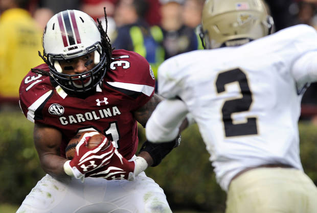 South Carolina running back Kenny Miles (31) runs the ball against Wofford cornerback Stephon Shelton (2) during the second half of an NCAA college football game, Saturday, Nov. 17, 2012, in Columbia, S.C. South Carolina defeated Wofford 24-7. (AP Photo/Stephen Morton)