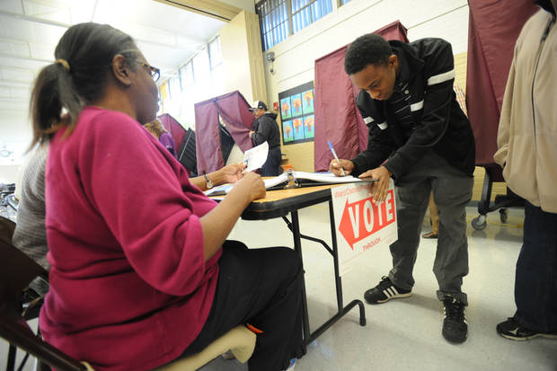 Jerome Williams signs in as he prepares to vote in his first presidential election, Tuesday, Nov. 6, 2012 in Shreveport, La. (AP Photo/The ( Shreveport ) Times, Douglas Collier)