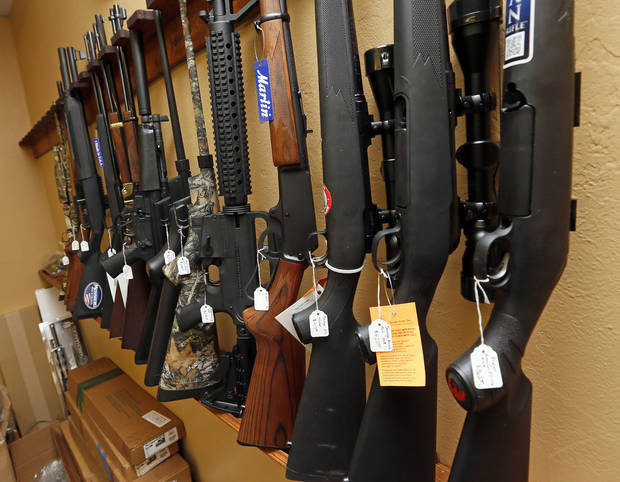 WEAPONS STORE: Rifles on the wall at Locked and Loaded, 14451 NE 23rd Street, in Choctaw, Okla., Wednesday, Jan. 16, 2013. Photo by Nate Billings, The Oklahoman