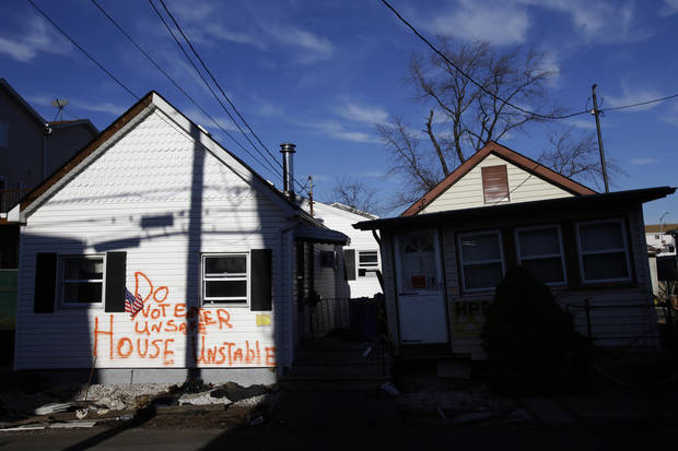Homes severely damaged by Superstorm Sandy are seen in Staten Island, New York, Thursday, Jan. 10, 2013.  (AP Photo/Seth Wenig)
