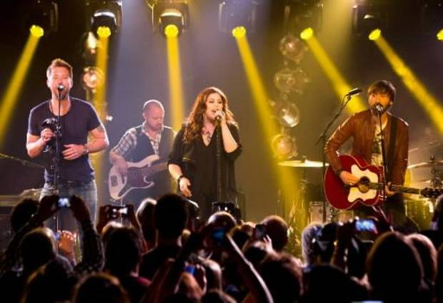 This May 8, 2013 file photo released by iHeartRadio shows members of the band Lady Antebellum, from left, Charles Kelley, Hillary Scott, and Dave Haywood during a performance in New York. (AP)