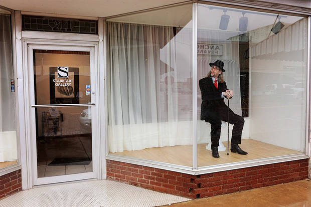 Kevin Stark poses in the front window of the Stark Art Gallery in Pauls Valley.   Photo by Calli Henry <strong>Photo by Calli Henry</strong>