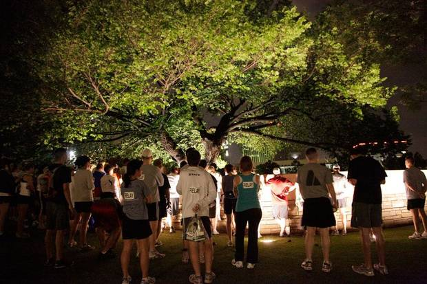 People take part in the service at the Survivor Tree before the Oklahoma City Memorial Marathon Sunday, April 26, 2009. Photo by Doug Hoke, The Oklahoman.